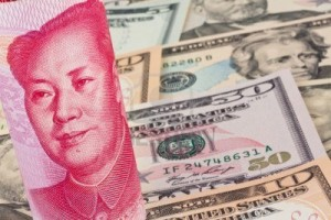 8408754-chinese-yuan-banknotes-and-u-s-dollars-multiple-currencies