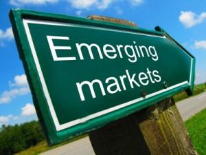 OCDE: Economiile emergente se stabilizează sau încetinesc, iar cele avansate îşi revin